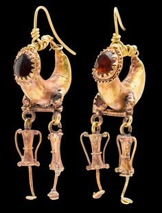 Jewelry Auction - Nov 30th 2016 - Imperial Roman gold earrings set with garnets, with amphora pendant drops. Mounted on removable gold earwires for wear. Estimate: $5,000 - $7,000. This and more important ancient art for sale on CuratorsEye.com.