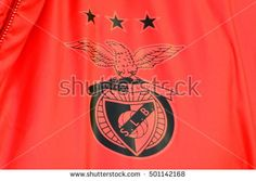 KYIV, UKRAINE - OCTOBER 18, 2016: Official S.L. Benfica logo printed on red fabric