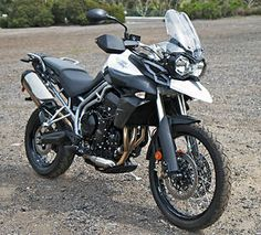 Triumph Tiger 800 ABS (2010)   £7000   Engine size: 799cc   Power: 94bhp   Top speed: 130mph  Weight: 210kg  Fuel Capacity: 19 litres  Miles per tank: 190  Average fuel consumption: 45.5mpg  Insurance group: NA  MCN 4*