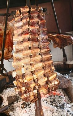 Photo about Barbecue argentina´s style, in vertical position, fire on floor. Image of steak, america, roasted - 5761780 Carne Asada, Brazilian Bbq, Brazil Food, Custom Bbq Pits, Open Fire Cooking, Steaks, Fire Food, Smoke Grill, Outdoor Restaurant
