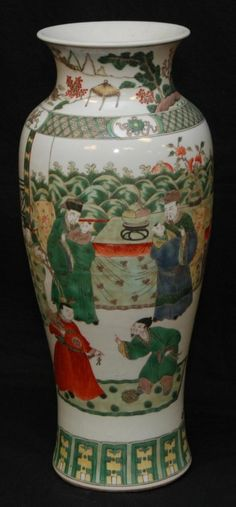 "CHINESE FAMILLE VERTE KANGXI PORCELAIN VASE 18th century Chinese Qing Dynasty hand painted enameled Famille Verte porcelain baluster form vase. Depicts a courtyard scene with men and children. Kangxi period (1662-1722). Measures 21 1/4"" height (53.9cm)."