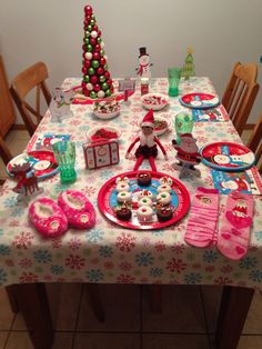 Day 1, 2015 - Our Elf on the Shelf Arrival Breakfast - Sprinkle served reindeer donuts, snowman donuts, and North Pole pancakes with whipped cream and Christmas candy (gummy bears, m&ms, hershey kisses, tootsie rolls and sprinkles), she also brought her suitcase filled with clothes and a gift: elf on the shelf socks, slippers and an ornament hidden on the tree - Elf on the Shelf