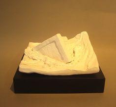 Ben Sheers Obsolete - 2012 Painted porcelain on hardwood base 23 x 20 x 12 cm Painted Porcelain, Feta, Hardwood, Base, Cheese, Natural Wood, Hardwood Floor
