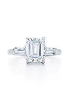 Kwiat Emerald Cut Diamond Engagement Ring. Emerald-cut diamond ring set in platinum with tapered baguette stones, price upon request, Kwiat