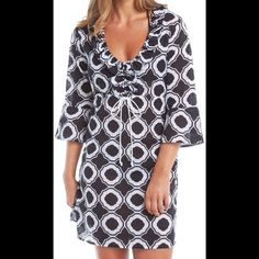 'Anna Bell' Tunic This light weight cotton tunic features a chic black and white honeycomb pattern with a drawstring rope tie, ruffle trim at the neckline and bell sleeves. Relaxed fit with adjustable drawstring at the natural waist. 100% cotton Mud Pie Swim Coverups