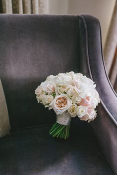 A blush, pale pink and white rose bouquet from one of our brides. White O'hara, Sweet Avalanche, Superbubbles and Vendela roses.