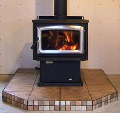 The tiles around our wood stove aren't this same shape, but I like these colors as an idea for repainting our wood stove surround Wood Stove Surround, Wood Stove Hearth, Brick Hearth, Fireplace Hearth, Wood Burner, Hearth Pad, Coal Stove, Pellet Stove, Diy Home Repair