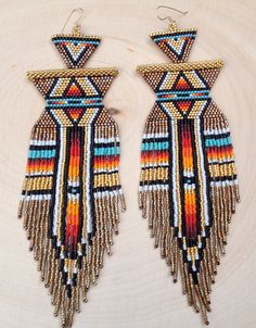 Beaded shoulder dusters w/leather backing