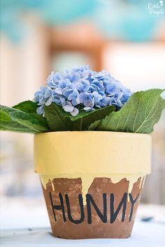"""Hunny"" pot flower centerpiece from a Winnie the Pooh Birthday Party on Kara's Party Ideas | KarasPartyIdeas.com (6)"