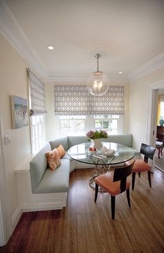 solution for banquette seating when the windows go down below seating.  Looks like they added a seating back with wood and allowed space between windows and banquette.  Great solution!