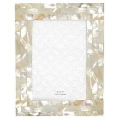 "Highlight beloved memories and artful sketches with this chic picture frame, perfect for bookcase, mantel, or writing desk.Product: Picture frameConstruction Material: Mother of pearl  Color: Cream  Features: Holds one 4"" x 6"" photoDimensions: 8"" H x 6"" W x 0.5"" D"