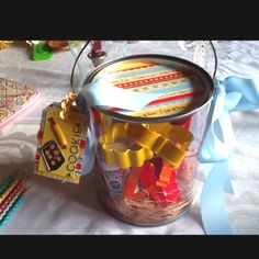 "Bridal Shower game prize or favor Clear container from Michaels filled with Betty Crocker sugar cookie mix in a pouch, cookie cutters, spatula, sprinkles, and measuring glass.  This is trimmed with ribbon, and handmade ""cookie"" tag."