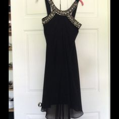 Black embellished night out dress Evening dress or wedding      Black flowy and embellished rhinestones and beads    100% polyester    Chiffon feel and look NOT chiffon though   New without tags.  Never worn. Scarlett Nite  Dresses Midi