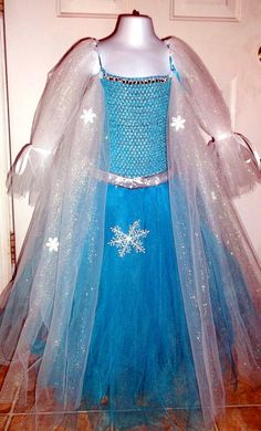 Elsa, the Snow Queen, inspired by Frozen. My oldest says she wants this. Guess I better get busy making it lol
