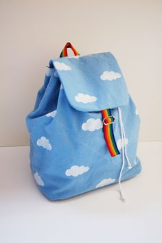 Cloudy with a chance of rainbows backpack // Toya for Petit a Petit and Family