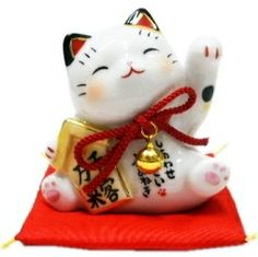 Maneki Neko's left hand invites good luck with our customers! Man beckoning