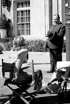 Carole Lombard and Alfred Hitchcock on the set of Mr and Mrs Smith, 1941.