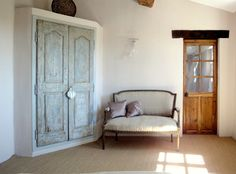 Old doors in a bedroom Old cupboard doors and glazed door to the bathroom. our achievements . Portes Antiques - french manufacturer, restoring and creation