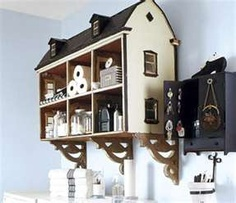 vintage doll house repurposed as a cute storage unit.