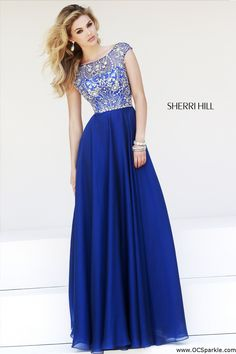 This Sherri Hill 32017 A-line dress is bursting with sparkling allure! Delightfully intricate patterns of twinkling accents whirl and swirl over the fitted top and.