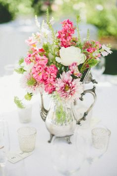 Sarah - I have a silver tea set that has a footed tray, a coffee pot (like in this pic), a tea pot (a little shorter and wider), and the sugar and creamer holders.  Don't know if would be interested in putting flowers in those?