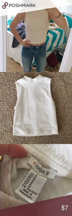 White Crop Top It's a size Medium crop top from forever 21. It zips up in the back and it's super stretchy! No imperfections Forever 21 Tops