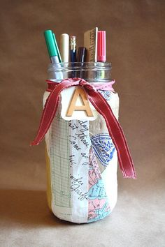 About those Mason jars...it's amazing what a little Modge, some paper scraps and a spare piece of ribbon can do!
