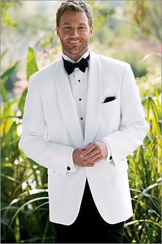 white tux and black bowtie! #groom #tuxedo  He will think he's James Bond,