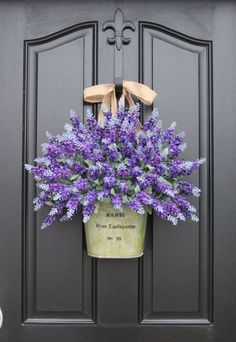 Is there anything prettier than a big bouquet of lavender? Visitors and passerby will be instantly taken with your home as they walk by this beautiful display. (This one features faux lavender, but if you're making your own, you can sub in dried lavender, too.) See more at Two Inspire You's Etsy shop.   - CountryLiving.com