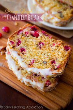 Moist & flavorful cranberry bread packed with orange zest, light cinnamon streusel, and an orange glaze. sallysbakingaddiction.com