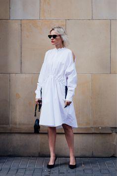 White dress and narrow black sunglasses