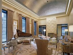 Silver leaf adds drama to the living room& barrel-vaulted ceiling in a Manhattan penthouse decorated by Charles Allem. Velvet curtains, hand-printed in Italy hang from beveled-mirror rods of his design.