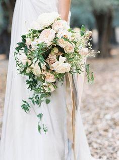 white peonies, ranunculus, Sahara roses with a nude ribbon