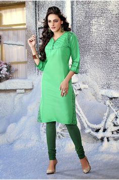 Light green color pure cotton Fabric Kurti. This Kurti flaunting contrast geometric pattern prints on the yoke with tie-up danglers on the mid. Striped panel hemline prettifies the look.  Rate:- 695/- Only For orders contact +919870725209 or Whtsapp