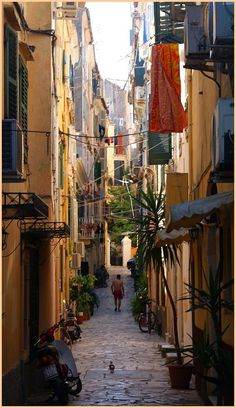 Corfu, Greece - Meandering down the narrow, colourful streets, eating feta… Oh The Places You'll Go, Places To Travel, Places To Visit, Myconos, Corfu Town, Corfu Island, Places In Greece, Beaux Villages, Adventure Is Out There