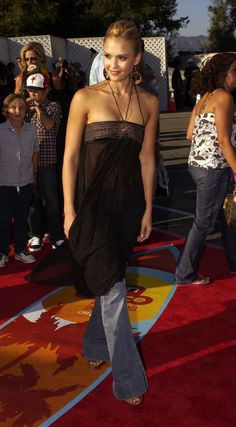 Flowy, hippie-inspired dresses over jeans. Bonus points for flare jeans. | 27 Forgotten Early 2000s Fashion Trends