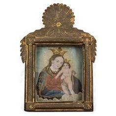 19 th century Virgin and child Retablo . I love the tin frame.