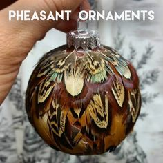 Originally written for and posted on ReelCamo Girl. I love birds of all sorts. They are all so beautiful, and each feather is unique. While looking through a bag of pheasant feathers, you might ini… Feather Wreath, Feather Crafts, Feather Art, Crafts With Feathers, Diy Christmas Ornaments, Rustic Christmas, Holiday Crafts, Christmas Decorations, Christmas Flowers