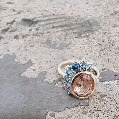 Another look @1011makeup's custom Morganite, Montana Sapphire & Australian Opal ring!  Love this one so much! ⠀ Also, just blogged about making this ring and what our custom process looks like.  Check it out!  Link in profile...✨ #loveyourbones