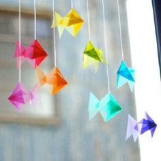 Something in my brain hurts when I try Origami, but I'd love to have these bright fish to hang in a sunny window.