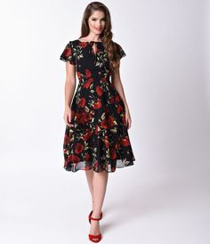 Welcome to the Formosa, darlings. The Formosa dress is a pine-worthy 1940s inspired swing in a breezy black and red rose floral fabrication, fabulously fresh from Unique Vintage! A feminine chiffon frock boasting a self tie keyhole neckline met with flutt