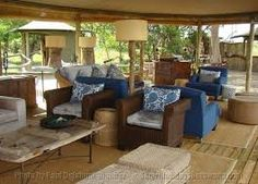The lounge area is inviting. Okavango Delta, Outdoor Furniture Sets, Outdoor Decor, Lounge Areas, Beautiful Islands, Wildlife, Home Decor, Living Rooms, Decoration Home