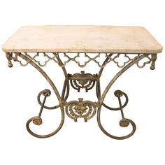 French Style Iron Pastry Table with Limestone Top | From a unique collection of antique and modern console tables at http://www.1stdibs.com/tables/console-tables/