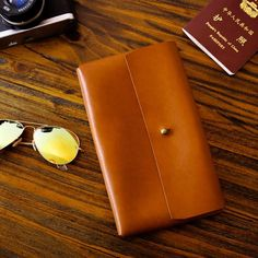 Overview:  Design: Handmade leather longwallet In Stock: Made to order (2-6 days) Include: LongWallet Custom:Add initials Color:Yellow Brown, Dark Coffee Material: Cowhide Measures: 22cm x13.5cm x 2cm Weight: 0.25kg Slots: 1fullbll slot Style: Handmadeleather tooled longwallet clutch  Note:  Each item wil