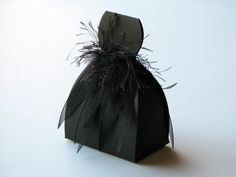 Black Swan Halloween Favor Boxes. $20.00, via Etsy. I like the look of the bag and black feathers.