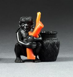 "CORAL AND EBONY NETSUKE Late 18th/Early 19th Century  By Miwa. Depicting a diver with a splintwork basket. Height 1.6""."