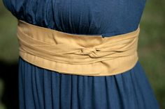 DIY Fabric Wrap Belt- I think it would be cute if it was a little bit smaller. The fabric is too wide in the picture.