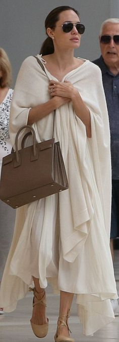 Who made  Angelina Jolie's aviator sunglasses, brown tote handbag, and nude ballet wrap shoes?