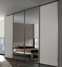 Sliding bedroom wardrobe with mirror in center-in Wardrobes from Wardrobe Design Bedroom, Wardrobe Furniture, Bedroom Furniture, Mirrored Wardrobe, Modern Wardrobe, Bedroom Mirror With Lights, Living Room Panelling, Building A Container Home, Sliding Wardrobe Doors