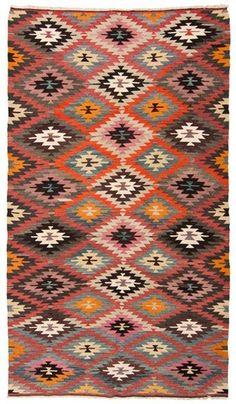 ethnic rug with mod furniture.